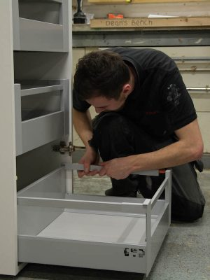 Workers building draw unit
