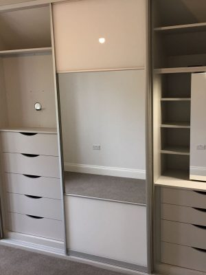Storage inside sliding wardrobe
